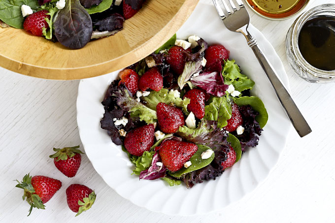 This Spring Greens, Strawberry, and Feta Salad with balsamic vinaigrette has a sweet salty combination that is sure to tease the taste buds. | Food to gladden the heart at RotiNRice.com