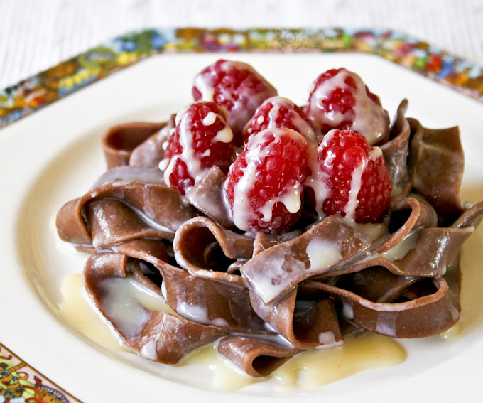 Chocolate Pasta with White Chocolate Liqueur Sauce - a different yet delightfully chocolatey dessert topped with luscious raspberries.| RotiNRice.com