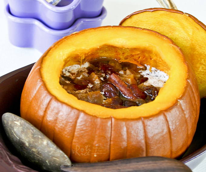 Impress family and friends with this hollowed out Sweet Stuffed Pumpkin dessert filled with mixed dried fruits and spices. It is warm, delicious, and perfect for the holidays.
