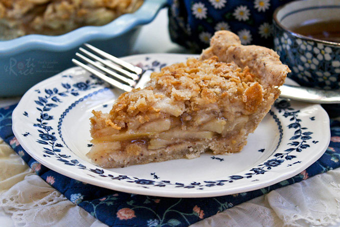 This delicious Pear Pie with Crumb Topping has a flaky gluten free Hazelnut Crust and a moist ooey gooey pear filling. Perfect with a cup of tea! | RotiNRice.com