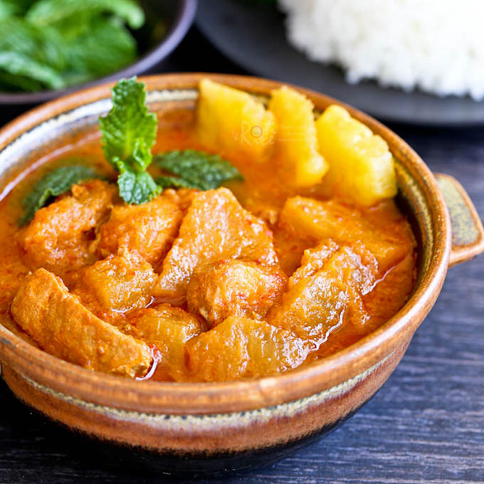 This spicy and tangy Pineapple Curry with Salmon and coconut milk is sure to whet your appetite. Delicious served with a steaming bowl of rice. | RotiNRice.com