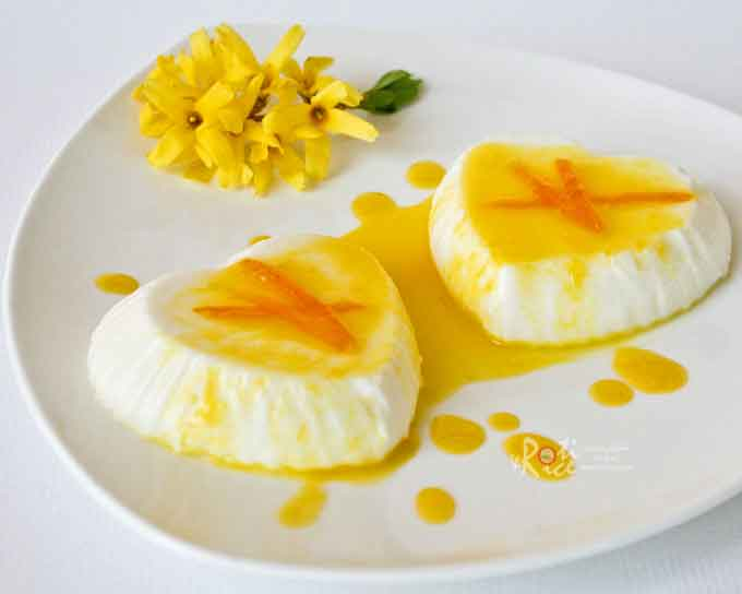 This luscious and fragrant Orange Blossom Panna Cotta is made with a dash of orange blossom water. It combines beautifully with the citrusy orange sauce. | RotiNRice.com