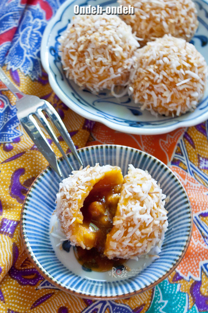 These balls of Ondeh-Ondeh are so fun to eat. Made with sweet potatoes and glutinous rice flour rolled in coconut with a little surprise on the inside. | RotiNRice.com