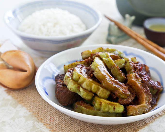 Braised Pork Ribs and Bitter Gourd in Black Bean Sauce - salty fermented black beans act as a perfect foil to the bitter gourd in this flavorful dish. | RotiNRice.com