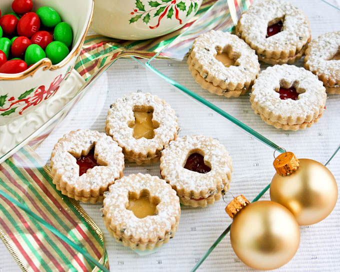 These sugar-dusted, jam-packed, egg-free, and sweetly scented Lavender Linzer Cookies are a must-have for the holidays. They are so festive and delicious! | RotiNRice.com