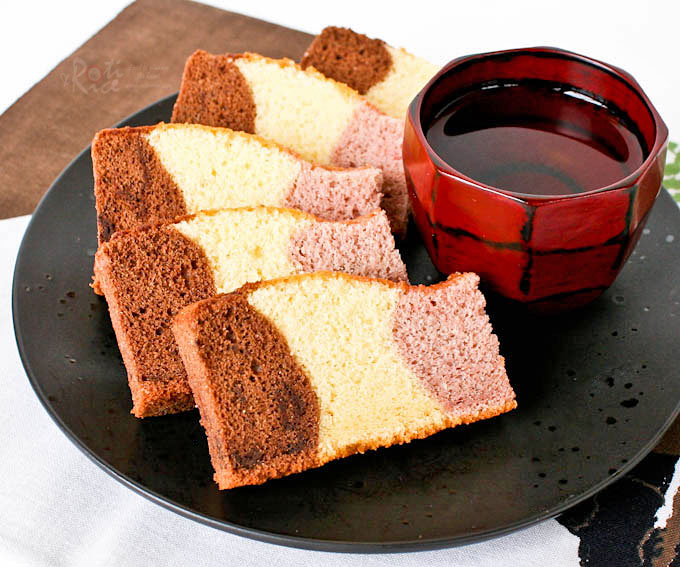 Fabulous tri-colored Neapolitan Kasutera (Neapolitan Castella) with chocolate, honey, and strawberry flavored cakes baked in a single pan. | RotiNRice.com