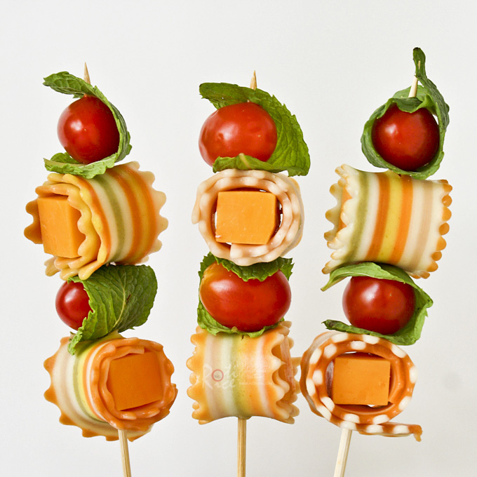 These Antipasti Kabobs are made with colorful striped pasta, cheese, grape tomatoes, and mint leaves. They are a fun and tasty addition to any party table. | Food to gladden the heart at RotiNRice.com