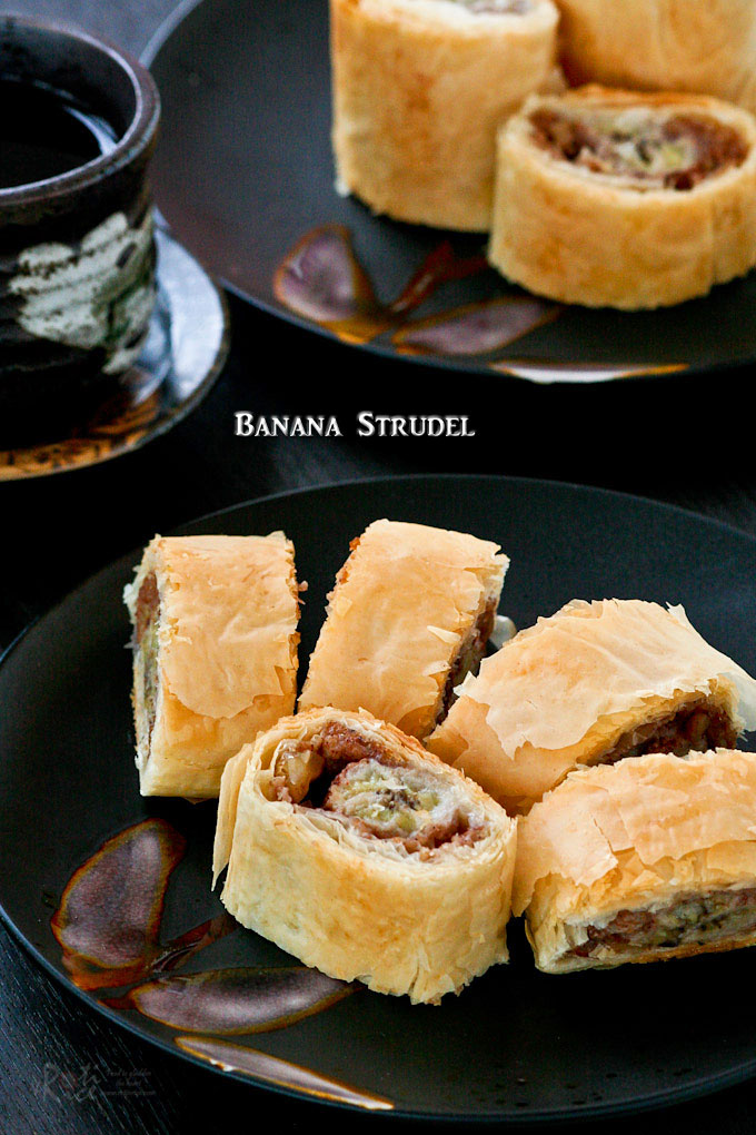 Easy Banana Strudel with cinnamon flavored bananas, breadcrumbs, and walnuts wrapped in fillo dough. Delicious on its own or with a scoop of ice cream. | RotiNRice.com