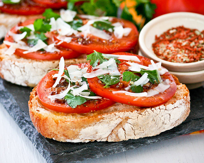 Bruschetta al Pomodoro (Bruschetta with Tomatoes) - juicy vine ripened tomatoes, Italian parsley, and freshly shaved parmesan reggiano on ciabatta. | RotiNRice.com