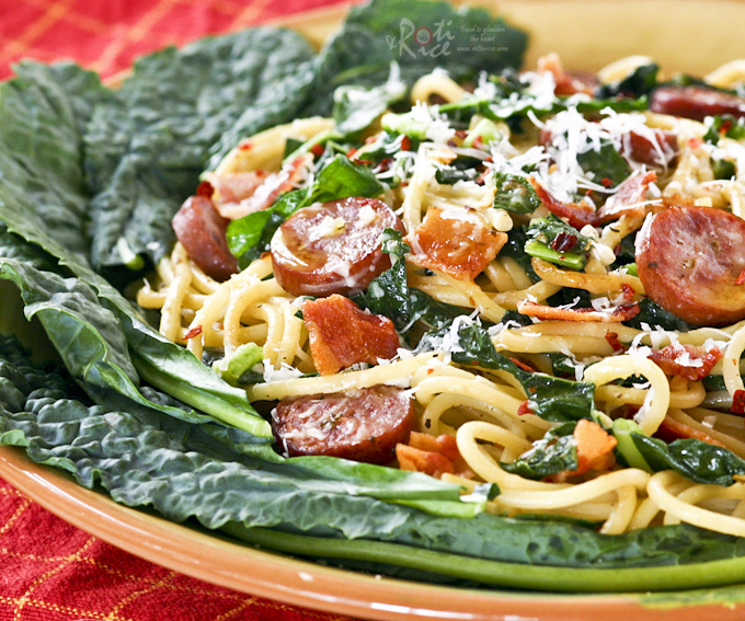 Kale Sausage Spaghetti - a pasta with bold flavors combining Polish sausage, earthy kale, spicy red pepper flakes, garlic, and bacon. | RotiNRice.com