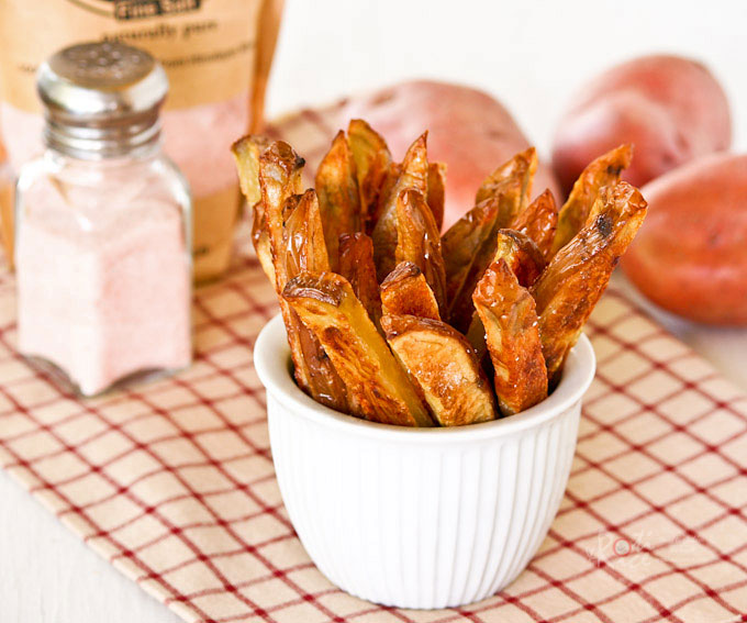 Love French fries but don't like deep frying? Try these Baked French Fries. Only three tablespoons of oil used for two pounds of potatoes. | RotiNRice.com