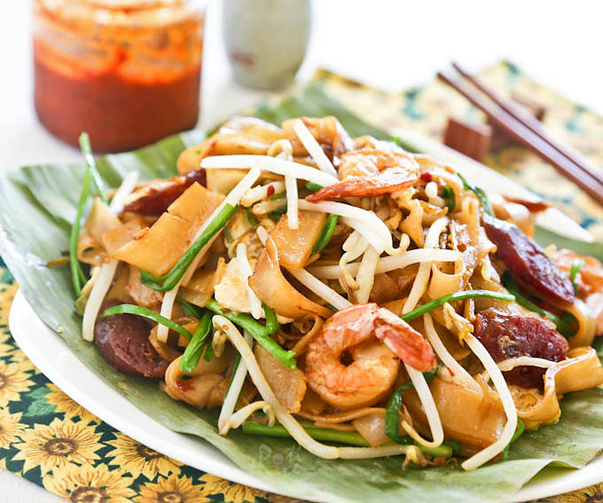 The ever popular Char Koay Teow or stir fried rice strips with shrimps, Chinese sausage, bean sprouts, and chives with step-by-step instructions. | RotiNRice.com