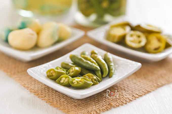 Pickled Green Chilies and Garlic are wonderful eaten with noodles. This spicy condiment is often served with stir fried noodles in Malaysia and Singapore. | RotiNRice.com