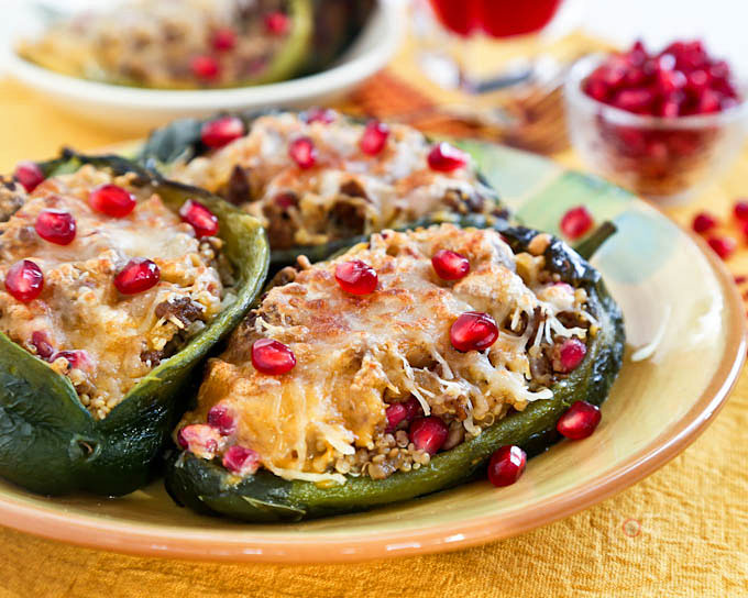 These Beefy Pomegranate Quinoa Stuffed Poblanos are delicious as an appetizer or light lunch. The addition of pomegranate arils give them a festive touch. | RotiNRice.com