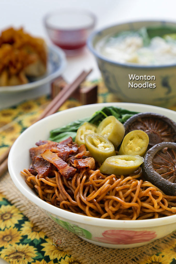 Dry style Wonton Noodles tossed in a dark soy sauce dressing served with wontons, braised mushrooms, and pickled green chilies. | RotiNRice.com
