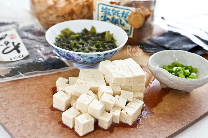 Quick, easy, and tasty Miso Soup with wakame (seaweed), tofu, and green onions. Step-by-step instructions included for homemade dashi stock in related post. | RotiNRice.com