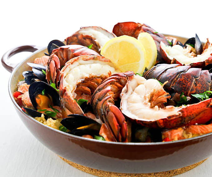 Wow family and friends with this delicious Lobster Paella studded with succulent lobster tails, mussels, salmon, and chorizo. They'll be back for seconds! | RotiNRice.com