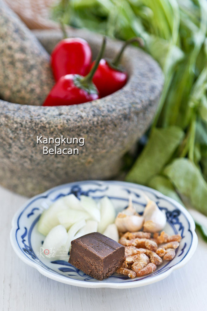 Kangkung Belacan is a Malaysian spicy water spinach stir fry flavored with chilies and shrimp paste. Full of umami flavor and delicious with steamed rice. | RotiNRice.com