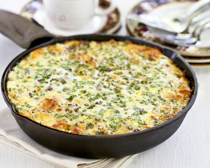 Wake up to this delicious Sausage, Potato, and Egg Skillet topped with shredded cheese and green onions. Makes a wonderful weekend breakfast or brunch treat for the family. | RotiNRice.com