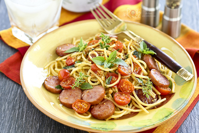 Quick and easy Pasta with Fresh Herbs, Sausage, and Tomatoes perfect for busy weeknights. Dinner can be ready in less than 30 minutes. | RotiNRice.com