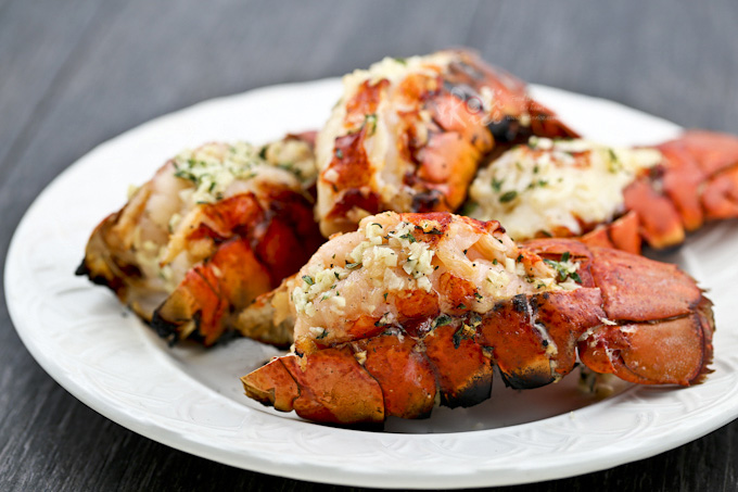 These Grilled Lobster Tails are the ultimate appetizers. Only minutes to prepare and absolutely delicious hot off the grill. | RotiNRice.com