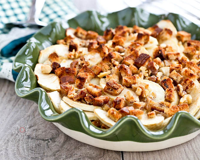 Easy to make Apple Crisp with cinnamon bread, crystallized ginger, and walnuts. Deliciously crisp and warmly spiced. Best ever dessert for cooler weather! | RotiNRice.com