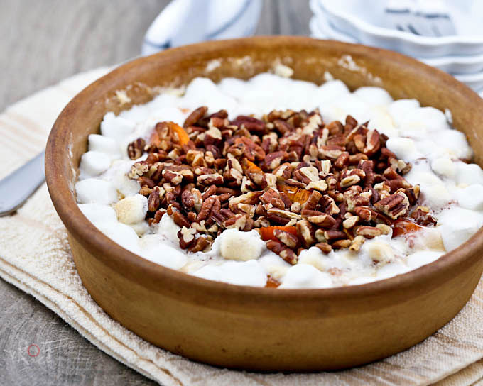 Easy Sweet Potato Casserole with marshmallow and candied pecan topping. It is a holiday mainstay whether eaten as a side dish or dessert. | RotiNRice.com