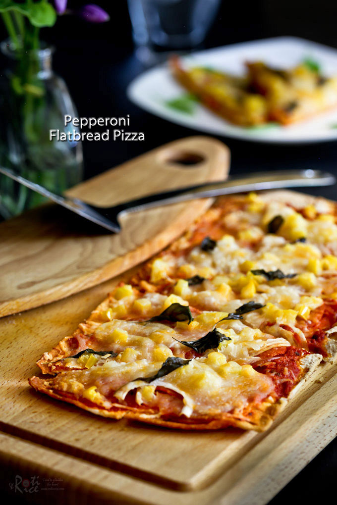 This Pepperoni Flatbread Pizza makes an easy light meal or snack. Can be prepared in minutes using prepackaged ingredients and some fresh produce. | RotiNRice.com