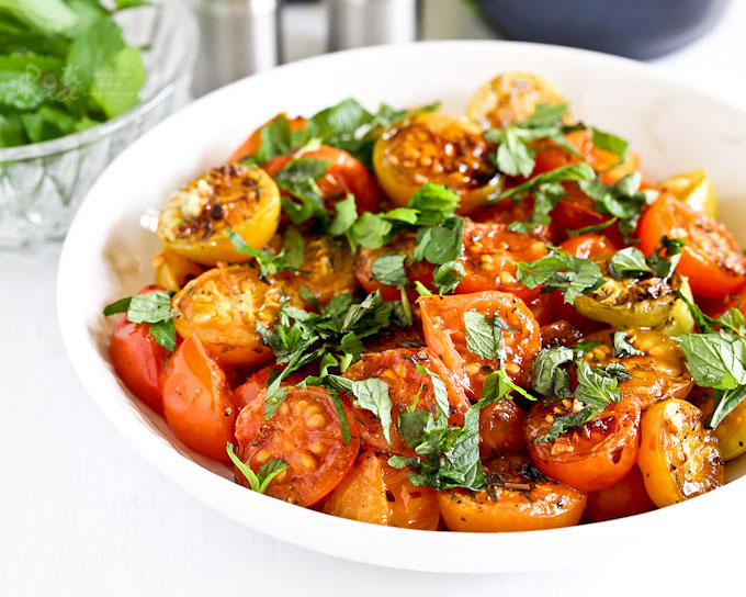 These simple and tasty Roasted Cherry Tomatoes are a great way to enjoy the abundance of a fall harvest. Only 20 minutes to prepare. | RotiNRice.com